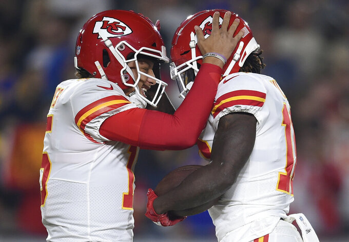 FILE - In this Nov. 19, 2018, file photo, Kansas City Chiefs wide receiver Tyreek Hill, right, celebrates after he caught a pass for a touchdown from quarterback Patrick Mahomes, left, during the first half of the team's NFL football game against the Los Angeles Rams in Los Angeles. Mahomes has just about everyone back in his quest to get the Chiefs to their first Super Bowl in 50 years, including star receiver Hill, who was cleared to play by the NFL following an offseason domestic violence investigation. (AP Photo/Kelvin Kuo, File)