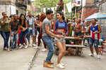 """This image released by Warner Bros. Picures shows a scene from the upcoming film """"In the Heights,"""" which will open the Tribeca Film Festival in June. (Macall Polay/Warner Bros. Entertainment via AP)"""