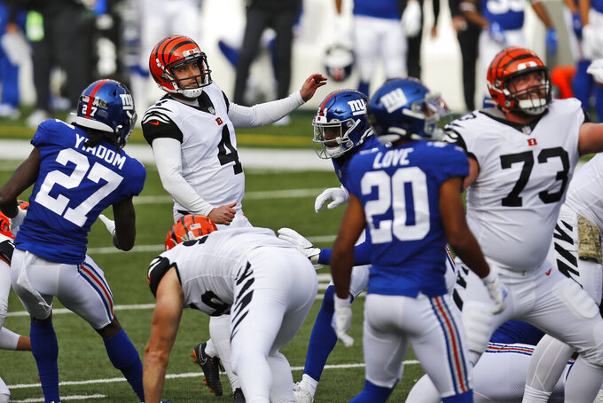 Cincinnati Bengals kicker Randy Bullock (4) watches the ball after kicking a 44-yard field goal during the first half of NFL football game against the New York Giants, Sunday, Nov. 29, 2020, in Cincinnati. (AP Photo/Aaron Doster)