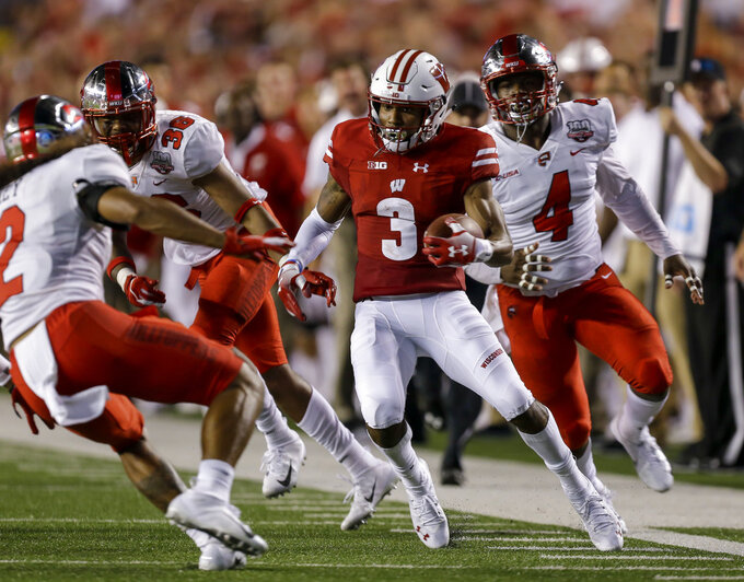 Wisconsin wide receiver Kendric Pryor (3) runs against Western Kentucky's Devon Key, left, Andre Haynes and Der'Quione Mobley, right, during the first half of an NCAA college football game Friday, Aug. 31, 2018, in Madison, Wis. (AP Photo/Andy Manis)