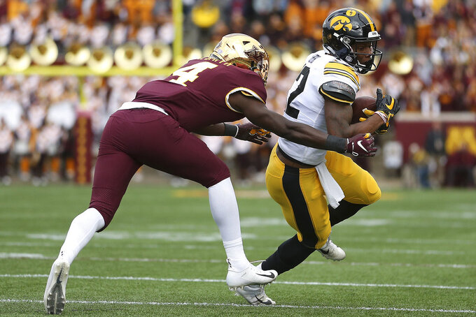 Iowa wide receiver Brandon Smith controls the ball against Minnesota's defensive back Terell Smith during an NCAA college football game Saturday, Oct. 6, 2018, in Minneapolis. (AP Photo/Stacy Bengs)