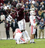 Texas A&M linebacker Buddy Johnson (1) celebrates after Mississippi kicker Luke Logan, right, missed a field goal during the fourth quarter of an NCAA college football game Saturday, Nov. 10, 2018, in College Station, Texas. Texas A&M won 38-24. (AP Photo/David J. Phillip)
