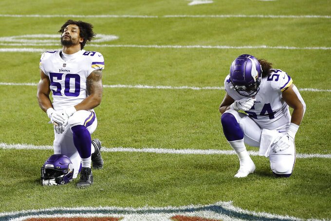 FILE - In this Monday, Nov. 16, 2020 file photo, Minnesota Vikings outside linebacker Eric Wilson (50) and middle linebacker Eric Kendricks (54) pray before an NFL football game against the Chicago Bears in Chicago. Eric Kendricks and the Minnesota Vikings have had a rough year between the lines, but the 2019 All-Pro linebacker, whose 2020 season has been shortened by a calf injury, has made quite an impact off the field. He's the team's nominee for the Walter Payton Man of the Year award, for his community work focused on criminal justice reform. (AP Photo/Kamil Krzaczynski, File)