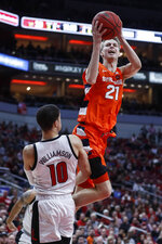 Syracuse forward Marek Dolezaj (21) shoots over Louisville guard Samuell Williamson (10) during the first half of an NCAA college basketball game Wednesday, Feb. 19, 2020, in Louisville, Ky. (AP Photo/Wade Payne)