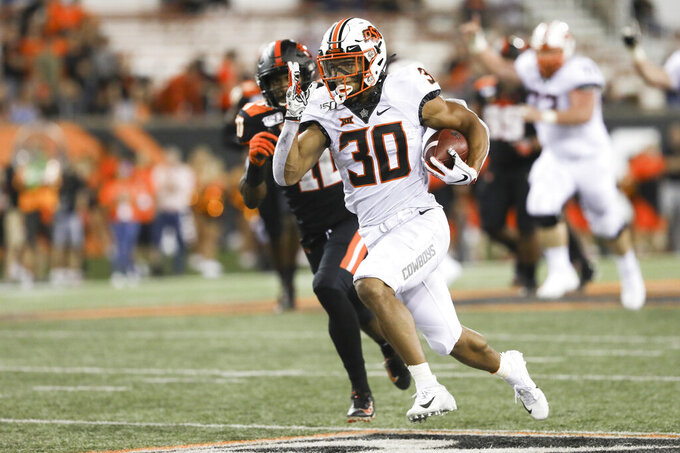 Oklahoma State wide receiver Chuba Hubbard (30) sprints up the field during the second half of an NCAA college football game with Oregon State in Corvallis, Ore., Friday, Aug. 30, 2019. Oklahoma State won 52-36. (AP Photo/Amanda Loman)