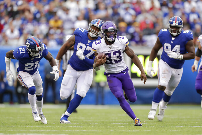 Minnesota Vikings running back Dalvin Cook (33) runs the ball against the New York Giants during the third quarter of an NFL football game, Sunday, Oct. 6, 2019, in East Rutherford, N.J. (AP Photo/Adam Hunger)
