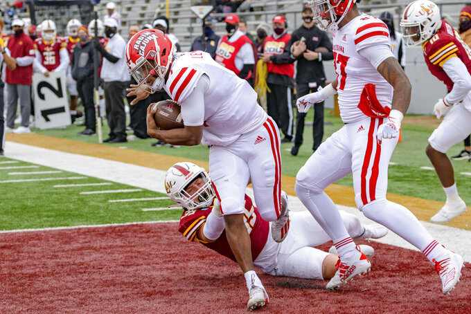 Louisiana-Lafayette quarterback Levi Lewis (1) scores at touchdown against Louisiana-Monroe linebacker Taylor Behl (35) in the first half of an NCAA college football game in Monroe, La., Saturday, Nov. 28, 2020. (AP Photo/Matthew Hinton)