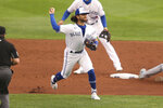 Toronto Blue Jays shortstop Bo Bichette throws to first for the out after fielding a ball hit by Tampa Bay Rays' Yandy Diaz during the third inning of a baseball game Saturday, Aug. 15, 2020, in Buffalo, N.Y. (AP Photo/Jeffrey T. Barnes)