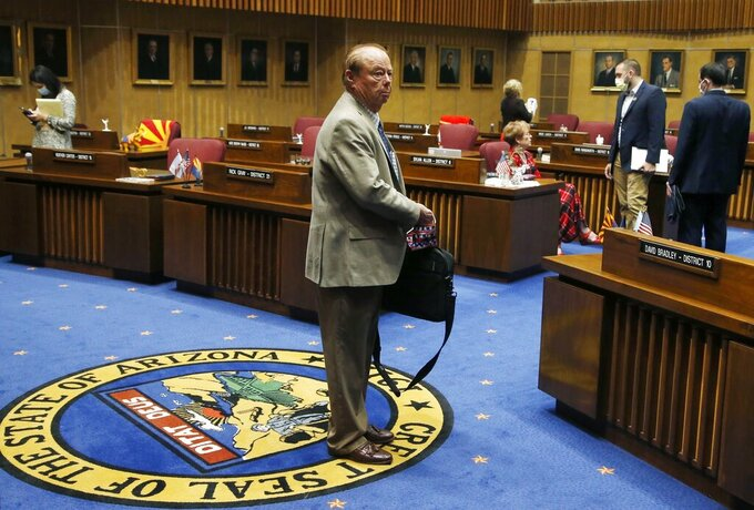 """FILE - In this May 26, 2020, file photo, Sen. Frank Pratt, R-Casa Grande, walks with his briefcase off the Senate floor after the Arizona Senate legislative session was adjourned in Phoenix. Longtime Arizona Rep. Frank Pratt has died following a long illness. He was 79. Speaker Rusty Bowers announced Pratt's death on Tuesday, Sept. 21, 2021, and called the Casa Grande Republican """"an irreplaceable figure in the Arizona state Legislature."""" (AP Photo/Ross D. Franklin, File)"""