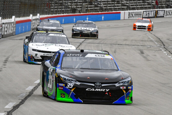 Driver Joey Gase races down the front stretch during a NASCAR auto race at Texas Motor Speedway, Saturday, March 30, 2019, in Fort Worth, Texas. (AP Photo/Larry Papke)