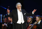 "FILE - In this Aug. 28, 2019 file photo, opera star Placido Domingo salutes spectators at the end of a concert in Szeged, Hungary. The 78-year-old singer who rose to stardom as a tenor has been confirmed to sing the baritone title role in ""Nabucco"" at the Zurich Opera House this Sunday. It will be his first time performing since stepping down Oct. 2 as general director of the Los Angeles Opera and withdrawing from future performances at the company. (AP Photo/Laszlo Balogh, File)"
