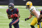 Houston Texans wide receiver Randall Cobb, left, catches a pass as Green Bay Packers linebacker Ty Summers defends during the second half of an NFL football game Sunday, Oct. 25, 2020, in Houston. (AP Photo/Eric Christian Smith)