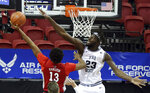 UNLV guard Bryce Hamilton (13) shoots as Utah State center Neemias Queta (23) defends during the first half of an NCAA college basketball game in the quarterfinals of the Mountain West Conference men's tournament Thursday, March 11, 2021, in Las Vegas. (AP Photo/Isaac Brekken)
