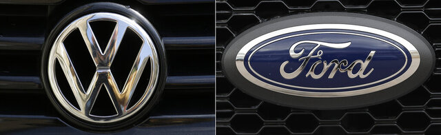 This photo combo shows the logo for Volkswagen, left, and Ford.  Ford and Volkswagen will work together to develop a small city van, a larger cargo van, a small pickup truck and an electric vehicle as part of their global alliance announced in 2019. The companies on Wednesday, June 10, 2020,  announced some details of what the venture will yield, with the city van created by VW and a 1-ton cargo van engineered by Ford to be sold by both companies.  (AP Photo/Markus Schreiber, file)