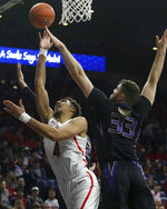 Arizona center Chase Jeter (4) is defended by Washington forward Sam Timmins (33) in the first half of an NCAA college basketball game in Tucson, Ariz., Thursday, Feb. 7, 2019. (Mamta Popat/Arizona Daily Star via AP)