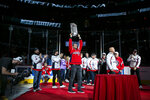 Washington Nationals first baseman Ryan Zimmerman holds up the World Series trophy as the team is recognized before an NHL hockey game Sunday, Nov. 3, 2019, in Washington. (AP Photo/Al Drago)