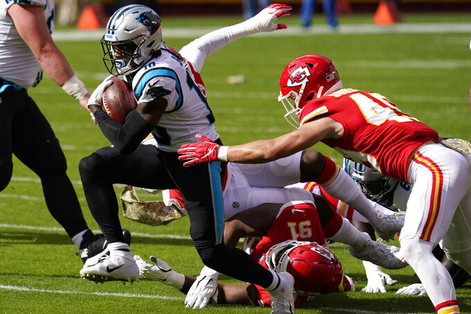 Carolina Panthers wide receiver Curtis Samuel (10) runs past Kansas City Chiefs defensive tackle Derrick Nnadi (91) and free safety Daniel Sorensen (49) during the first half of an NFL football game in Kansas City, Mo., Sunday, Nov. 8, 2020. (AP Photo/Jeff Roberson)