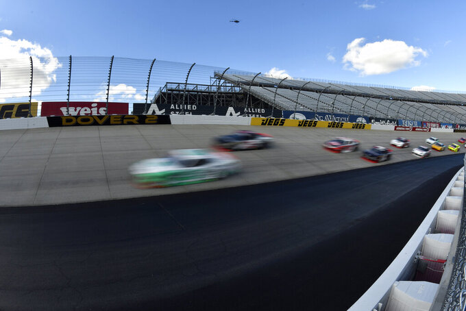 Driver Austin Cindric (#22) leads the field at the start of the  NASCAR Xfinity Series auto race, Saturday, Oct. 5, 2019, in Dover, Del. (AP Photo/Brien Aho)