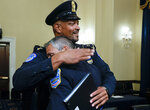 U.S. Capitol Police Sgt. Harry Dunn hugs Washington Metropolitan Police Department officer Michael Fanone after a House select committee hearing on the Jan. 6 attack on Capitol Hill in Washington, Tuesday, July 27, 2021. (Jim Bourg/Pool via AP)