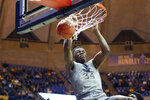 West Virginia forward Oscar Tshiebwe (34) dunks during the second half of the team's NCAA college basketball game against TCU on Tuesday, Jan. 14, 2020, in Morgantown, W.Va. (AP Photo/Kathleen Batten)