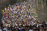 FILE - In this April 21, 2008, file photo, runners round a curve and climb a hill near during the first mile of the 112th Boston Marathon in Hopkinton, Mass. Due to the COVID-19 virus pandemic, the 124th running of the Boston Marathon was postponed from its traditional third Monday in April to Monday, Sept. 14, 2020. (AP Photo/Greg M. Cooper, File)