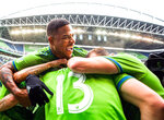 Seattle Sounders defender Roman Torres (29) celebrates a goal by Seattle Sounders forward Jordan Morris (13) during the first half of round one of a MLS Cup playoff soccer game against FC Dallas, Saturday, Oct. 19, 2019 in Seattle. (Andy Bao/The Seattle Times via AP)