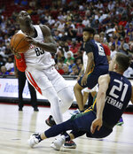 Houston Rockets' Rawle Alkins, left, drives into Utah Jazz's Frankie Ferrari during the first half of an NBA summer league basketball game Thursday, July 11, 2019, in Las Vegas. (AP Photo/John Locher)
