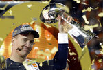 FILE - In this Feb. 7, 2016, file photo, Denver Broncos quarterback Peyton Manning holds up the Vince Lombardi Trophy after the Broncos defeated the Carolina Panthers 24-10 in NFL football's Super Bowl 50 in Santa Clara, Calif. Peyton Manning never wanted to leave Indianapolis. But when a neck injury forced him to miss a season and the Colts moved on to Andrew Luck, he couldn't have landed in a better place than Denver, where he produced a terrific second chapter to his Hall of Fame career. (AP Photo/Julie Jacobson, File)