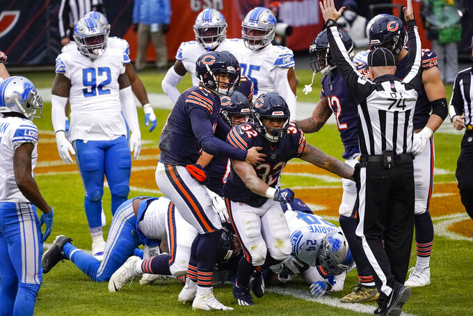 Chicago Bears running back David Montgomery (32) celebrates a touchdown with quarterback Mitchell Trubisky (10) in the first half of an NFL football game against the Detroit Lions in Chicago, Sunday, Dec. 6, 2020. (AP Photo/Charles Rex Arbogast)