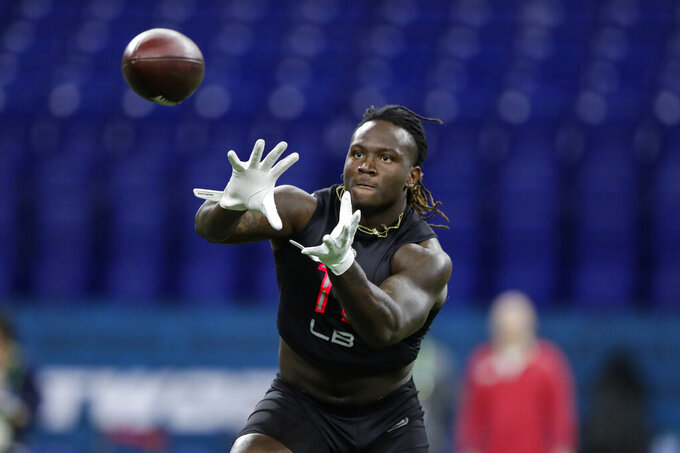 Mississippi State linebacker Willie Gay Jr. runs a drill at the NFL football scouting combine in Indianapolis, Saturday, Feb. 29, 2020. (AP Photo/Michael Conroy)