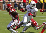 Florida Atlantic wide receiver Willie Wright (1) carries between Oklahoma defensive back Brendan Radley-Hiles (44) and linebacker Ryan Jones (33) in the first half of an NCAA college football game in Norman, Okla., Saturday, Sept. 1, 2018. (AP Photo/Sue Ogrocki)