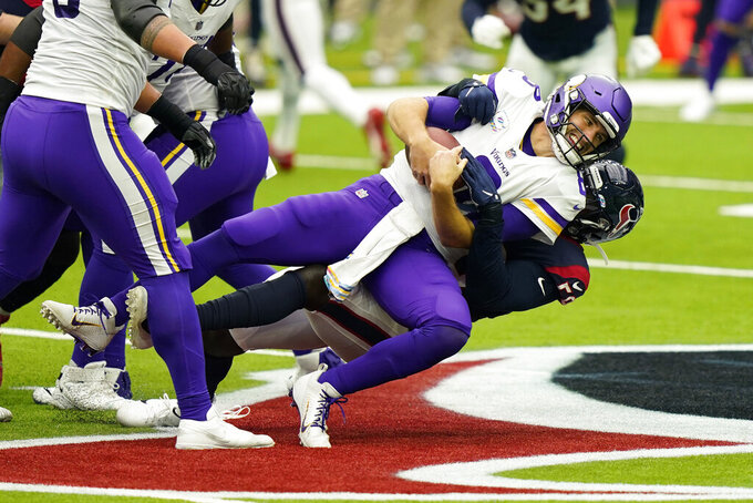 Minnesota Vikings quarterback Kirk Cousins (8) is sacked by Houston Texans outside linebacker Whitney Mercilus (59) during an NFL football game Sunday, Oct. 4, 2020, in Houston. (AP Photo/David J. Phillip)