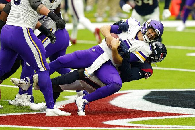 Minnesota Vikings quarterback Kirk Cousins (8) is sacked by Houston Texans outside linebacker Whitney Mercilus (59) during an NFL football game Sunday, Oct. 4, 2020, in Houston. (AP Photo/David J. Phillip)