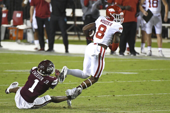 Arkansas wide receiver Mike Woods (8) breaks away from Mississippi State cornerback Martin Emerson (1) during the first half of an NCAA college football game in Starkville, Miss., Saturday, Oct. 3, 2020. (AP Photo/Thomas Graning)