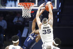 Xavier's Zach Hankins (35) blocks a shot by Georgetown's Jamorko Pickett (1) during the first half of an NCAA college basketball game, Wednesday, Jan. 9, 2019, in Cincinnati. (AP Photo/John Minchillo)