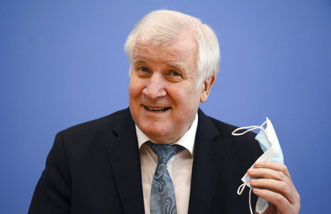 German Interior Minister Horst Seehofer attends a news conference about the crime statistics report for 2020 in Berlin, Germany, Thursday, April 15, 2021. (Annegret Hilse/Pool via AP)