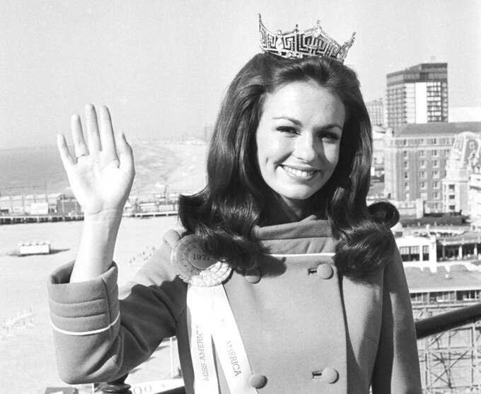 "FILE - In this Sept. 13, 1970, file photo, Twenty-one year old Phyllis George of Denton, Texas, waves against backdrop of he beach and ocean at Atlantic City, N.J. a day after she was named Miss America. George, the former Miss America who became a female sportscasting pioneer on CBS's ""The NFL Today"" and served as the first lady of Kentucky, has died. She was 70. A family spokeswoman said George died Thursday, May 14, 2020, at a Lexington hospital after a long fight with a blood disorder. (AP Photo/Bill Ingraham, File)"