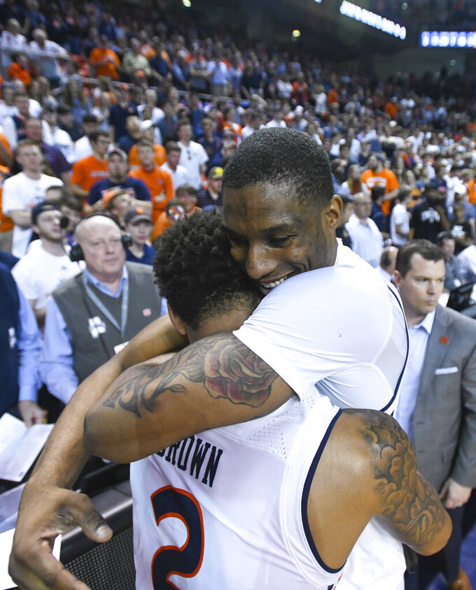 Auburn guard Bryce Brown (2) and Auburn forward Horace Spencer (0) celebrate the Tigers' 84-80 win over Tennessee after an NCAA college basketball game Saturday, March 9, 2019, in Auburn, Ala. (AP Photo/Julie Bennett)