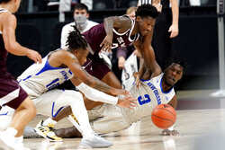 New Orleans guard Troy Green (3) dives for the ball as Texas A&M guard Quenton Jackson (3) defends during the first half of an NCAA college basketball game Sunday, Nov. 29, 2020, in College Station, Texas. (AP Photo/Sam Craft)