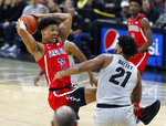 Arizona forward Ira Lee, left, pulls in a rebound as Colorado forward Evan Battey defend in the first half of an NCAA college basketball game Sunday, Feb. 17, 2019, in Boulder, Colo. (AP Photo/David Zalubowski)