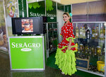 A model helps to promote the Spanish company Seragro at the Havana International Trade Fair, in Havana, Cuba, Wednesday, Nov. 6, 2019. The trade fair is where Cuba puts the best face on of its struggling economy. (AP Photo/Ismael Francisco)