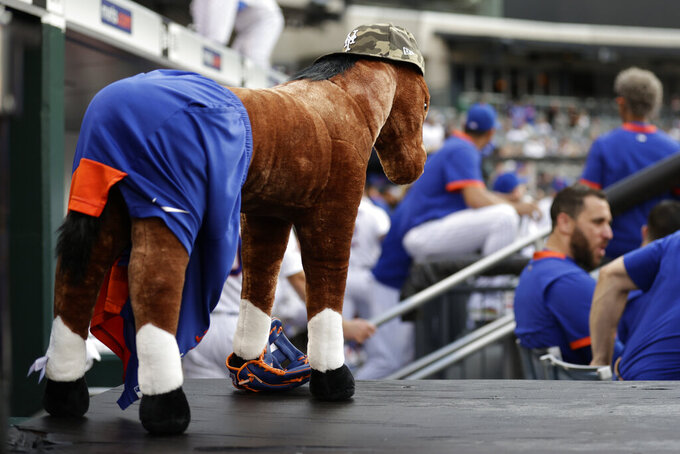 A stuffed horse dressed in New York Mets paraphernalia stands in the dugout before the Mets' baseball game against the Toronto Blue Jays, Friday, July 23, 2021, in New York. (AP Photo/Adam Hunger)