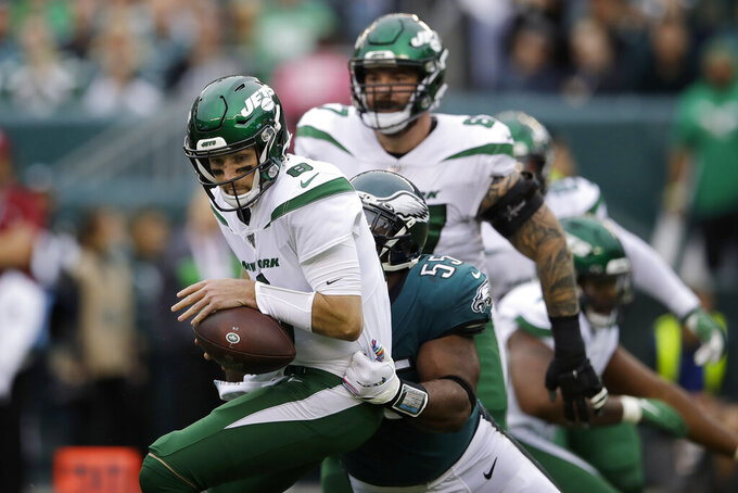 New York Jets' Luke Falk, left, is tackled by Philadelphia Eagles' Brandon Graham during the first half of an NFL football game, Sunday, Oct. 6, 2019, in Philadelphia. (AP Photo/Matt Rourke)