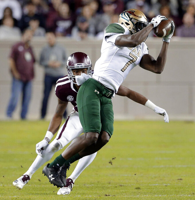 UAB wide receiver Xavier Ubosi (7) pulls in a reception in front of Texas A&M defensive back Charles Oliver during the first half of an NCAA college football game Saturday, Nov. 17, 2018, in College Station, Texas. (AP Photo/Michael Wyke)