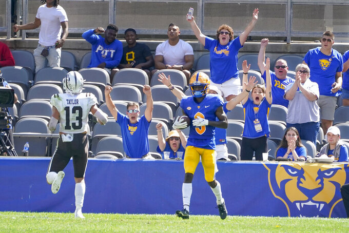 Fans cheer after Pittsburgh wide receiver Jordan Addison (3) made a catch for a touchdown past Western Michigan linebacker Harrison Taylor (13) during the first half of an NCAA college football game, Saturday, Sept. 18, 2021, in Pittsburgh. (AP Photo/Keith Srakocic)