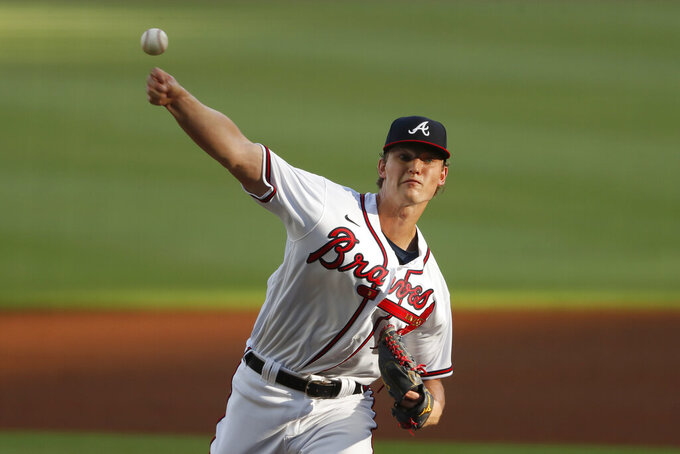 Atlanta Braves starting pitcher Mike Soroka works in the first inning of a baseball game against the New York Mets, Monday, Aug. 3, 2020, in Atlanta. (AP Photo/John Bazemore)