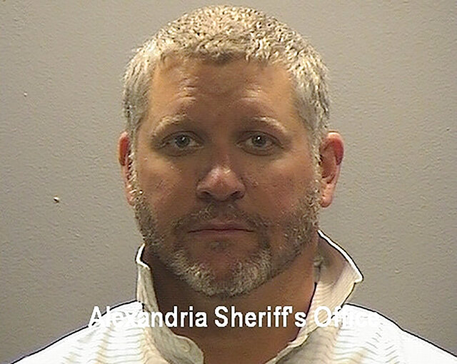 This photo provided by the Alexandria Sheriff's Office shows 44-year-old Garrison Courtney. A former federal public affairs officer has been sentenced to 7 years in prison for pretending to be an undercover CIA operative to persuade companies to give him millions of dollars. Courtney used to work as a spokesman for the Drug Enforcement Administration and before that for Republican congresswoman Katherine Harris of Florida. Courtney convinced companies to give him more than $4 million to provide what was supposed to be off-the-books funding for his classified task force. (Alexandria Sheriff's Office via AP)
