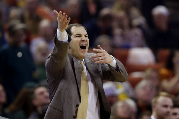 Baylor head coach Scott Drew argues a call during the first half of an NCAA college basketball game against Texas, Monday, Feb. 10, 2020, in Austin, Texas. (AP Photo/Eric Gay)