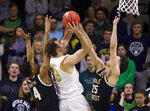 Notre Dame's John Mooney (33) goes up for a shot between Wake Forest's Jahcobi Neath (4) and Ismael Massoud (25) during the first half of an NCAA college basketball game Wednesday, Jan. 29, 2020, in South Bend, Ind. (AP Photo/Robert Franklin)