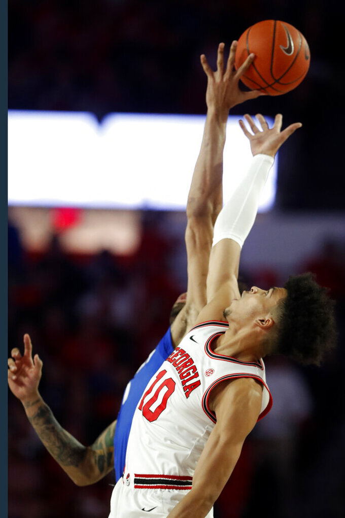 Georgia forward Toumani Camara (10) reaches for the opening tip in the first half of an NCAA college basketball games against Kentucky Tuesday, Jan. 7, 2020, in Athens, Ga. (AP Photo/John Bazemore)